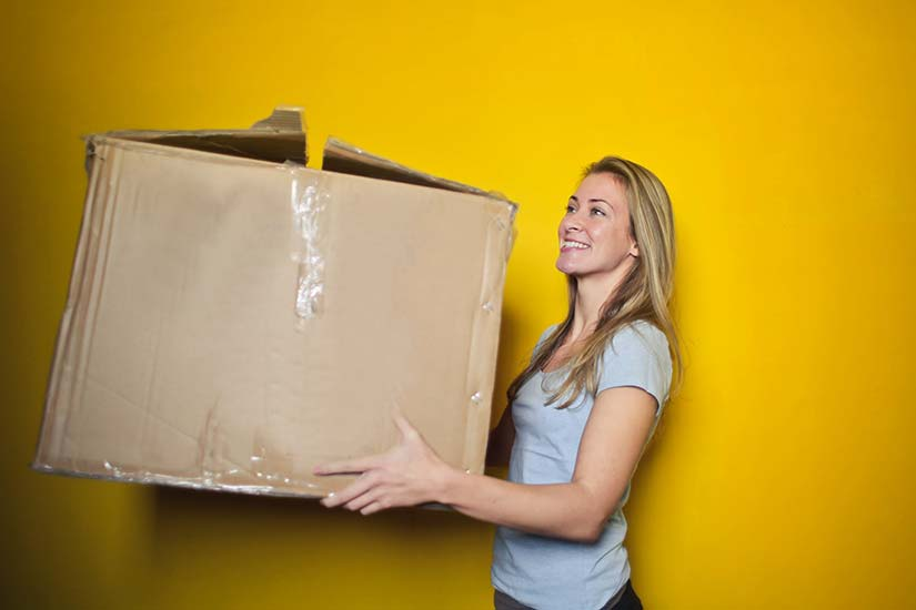 Woman Carrying Large Box